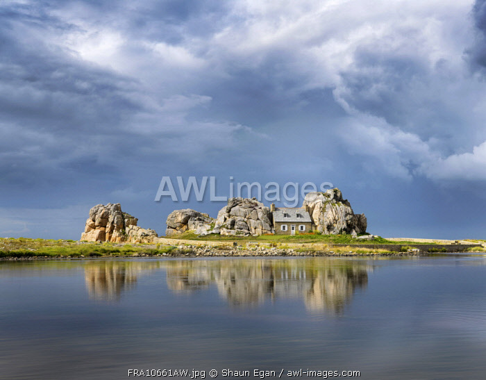 France, Brittany, Cote d'armor, Plougrescant, Le Gouffre house reflected in lake