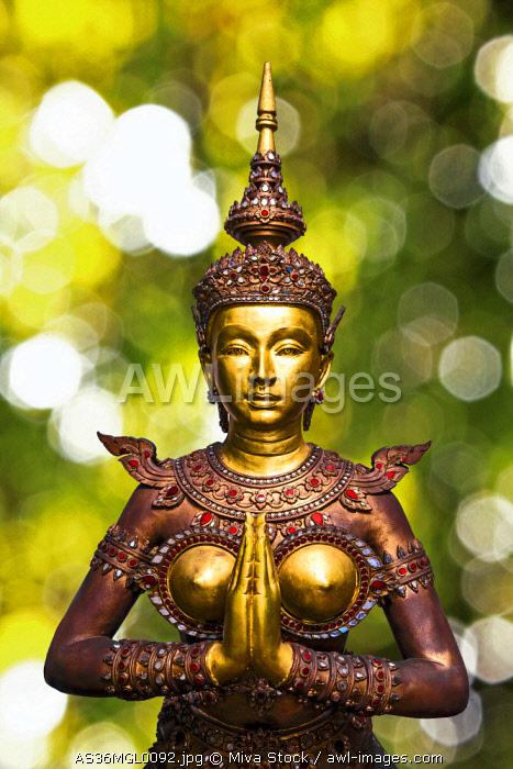 Bangkok, Thailand. Wat Phra Kaeo Grand Palace (Temple of the Emerald Buddha), Statue of Apsonsi, half woman half lion greeting and giving thanks.