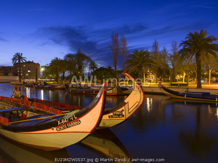 Sunset over the Canal Central with the traditional Moliceiro Boats. Aveiro in Portugal on the coast of the Atlantic. Because of the many channels Aveiro is called the Venice of Portugal.