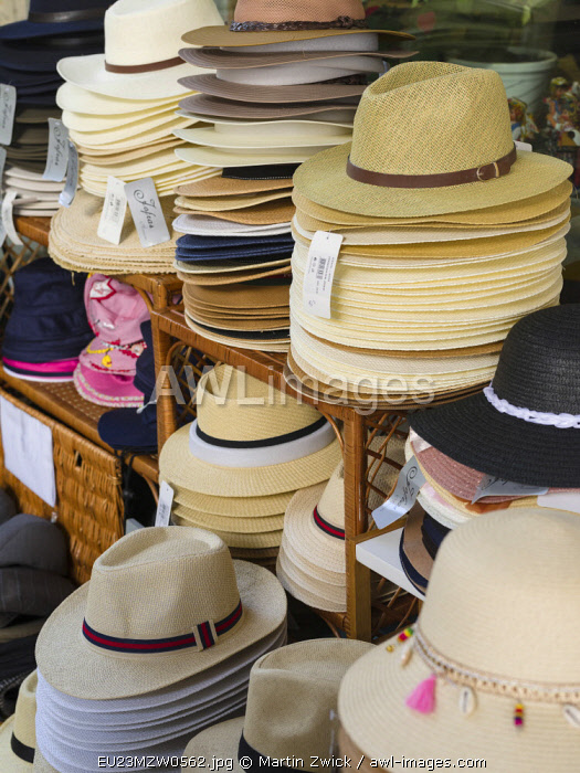 Selling of typical hats made of straw. Aveiro in Portugal on the coast of the Atlantic. Because of the many channels Aveiro is called the Venice of Portugal.