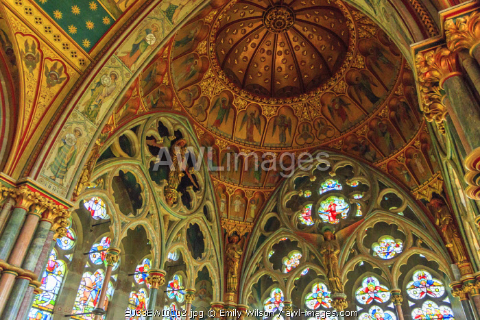England, North Yorkshire, Ripon. Fountains Abbey, Studley Royal, Cistercian Monastery. Victorian Gothic Revival Church of St. Mary. Interior chapel, rose window depicting crucifixion.