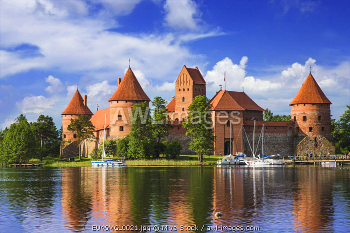 Lithuania, Vilnius. Trakai Castle reflected in Galve lake