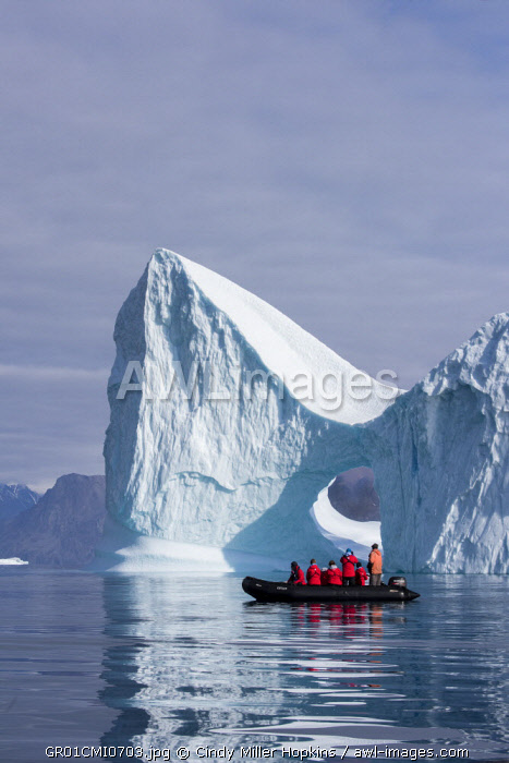 Eastern Greenland, Scoresbysund, aka Scoresby Sund, Bear Island, aka Bjorne Oer. Adventure tourists exploring huge icebergs from zodiac. (For Editorial Use Only)