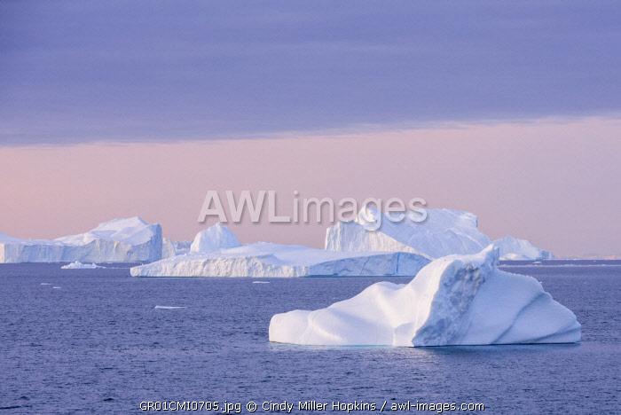 Greenland, Scoresbysund, aka Scoresby Sund, Nordvestfjord. Sunrise over huge icebergs.