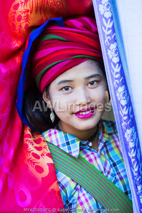 awl-images.com - Myanmar / Myanmar, Inle Lake. Pa-O girl selling fabric at Indein market.