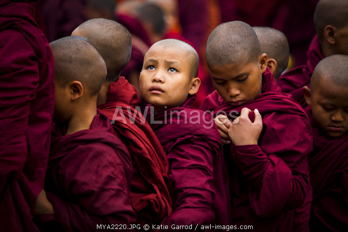 Myanmar, Bagan. Young novice monks lining up to receive alms at the Ananda Festival.