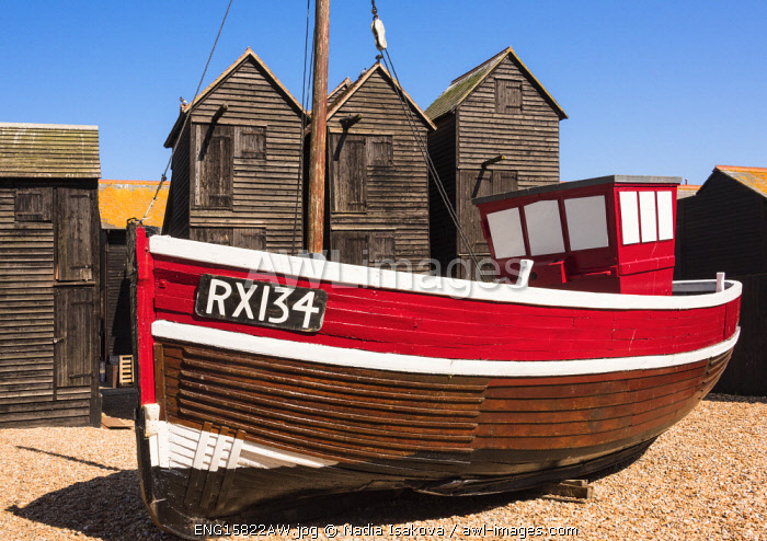 A fishing boat and the net shops ( a weather-proof storage for the fishing gear), Hasting Old Town, Sussex, England