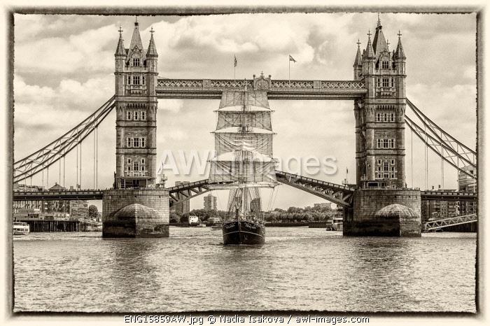 Tall Ship Thalassa passing through the Tower Bridge, London, England