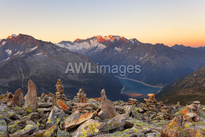 awl-images.com - Austria / Cairns on summit of Petersköpfl with Lake Schlegeispeicher and Hochfeiler group on the background, Zillertal Alps, Tyrol, Schwaz district, Austria.