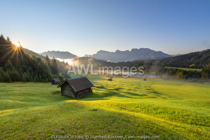 awl-images.com - Germany / Gerold Lake, Krün, Garmisch-Partenkirchen district, Upper Bavaria, Bavaria, Germany, Europe. Sunrise at Gerold Lake with the Karwendel Alps in the background