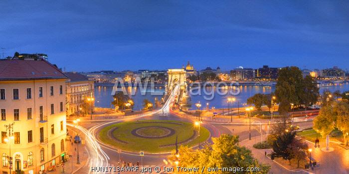 View of Chain Bridge (Szechenyi Bridge) and River Danube at dusk, Budapest, Hungary