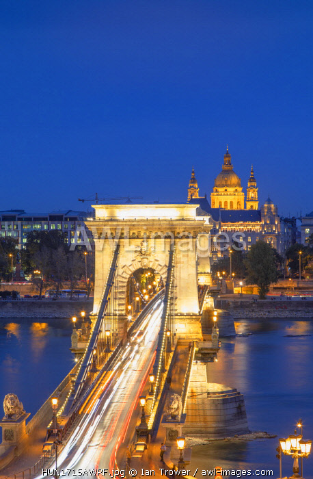 Chain Bridge (Szechenyi Bridge) and St Stephen's Basilica at dusk, Budapest, Hungary