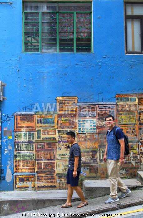 Men walking past mural on Graham Street, Soho, Central, Hong Kong Island, Hong Kong, China