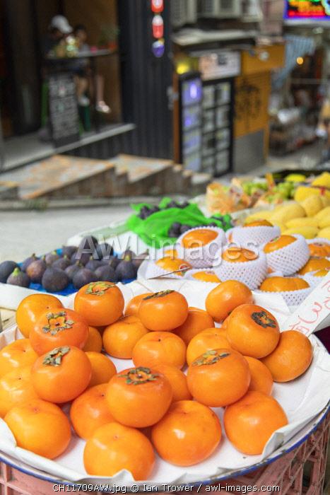 Persimmons on fruit stall on Peel Street, Soho, Central, Hong Kong Island, Hong Kong, China