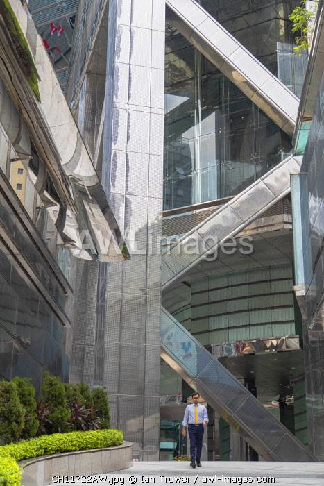 Man walking outside The Center skyscraper, Central, Hong Kong Island, Hong Kong, China