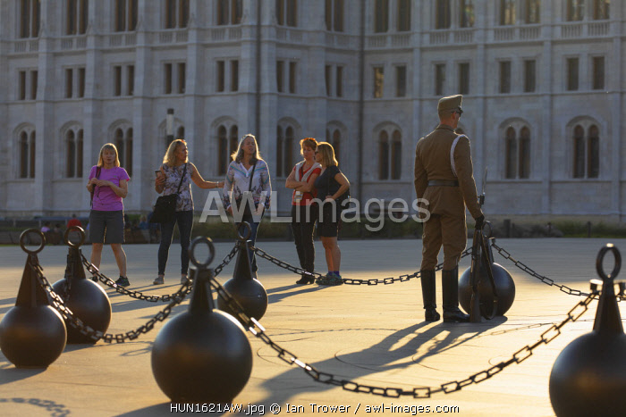 Tourists and soldier on duty outside Hungarian Parliament Building, Budapest, Hungary