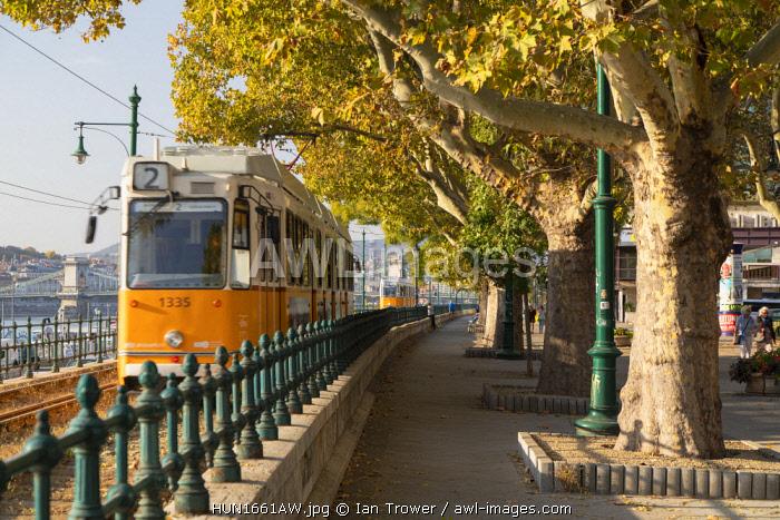 Tram passing along Danube Promenade, Budapest, Hungary
