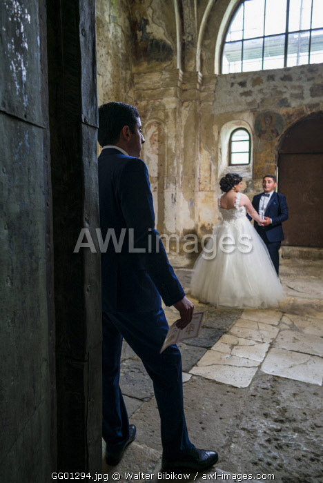 Georgia, Kutaisi, Gelati Monastery, couple posing for wedding photos