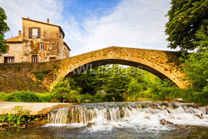 France, Occitanie, Lodeve.The 12 th Century Roman Bridge in the historic centre of Lodeve.