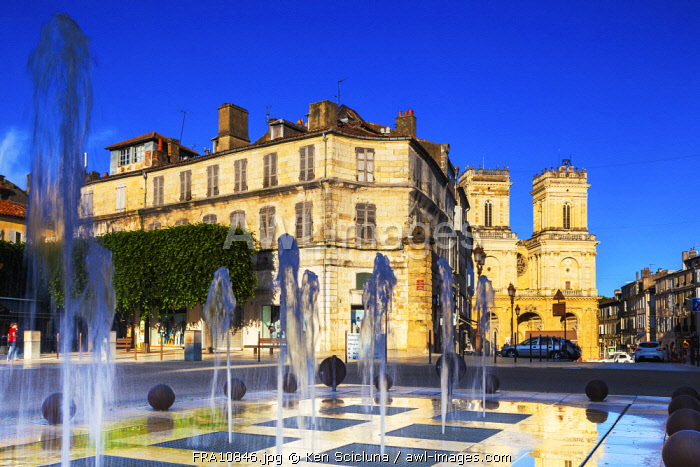 France, Occitanie, Auch. Fountain in the historic centre of Auch with the Cathedral visible in the background