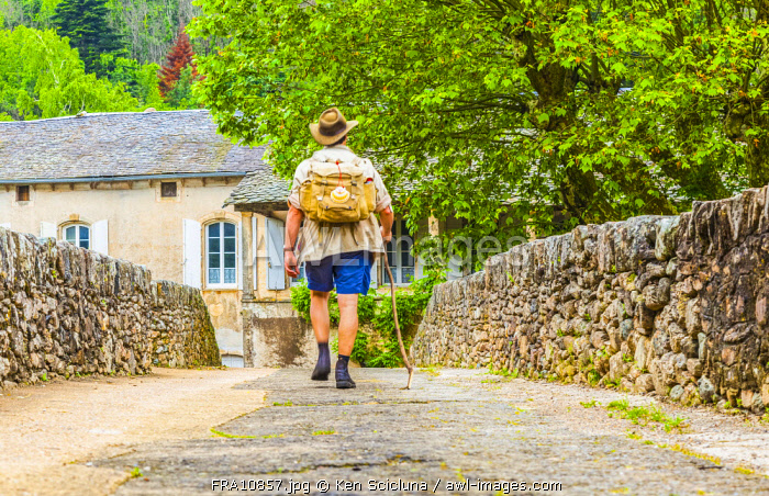 France, Occitanie, Le Bousquet d Orb region. A pilgrim of Santiago de Compostela on the route of Via Tolosana which departs in France on its way to the destination of Santiago de Compostela of which the route totals roughly 1500 km on foot. MR