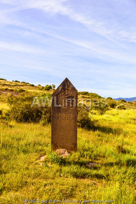 Spain, Navarre. Stone sign of the Camino di Santiago entering the Region of Navarre on the trail of the Camino Aragones towards Santiago de Compostela on the way to reach the Camino Frances at Puenta La Reina