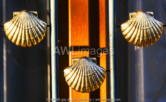 Spain, Castilla y Leon, Rabanal del Camino. The shell which is the symbol of the Camino di Santiago as initially pilgrims used to bring them back home as proof they had arrived in Galicia and picked them from the sea on windows of the Benedictine Monastery.