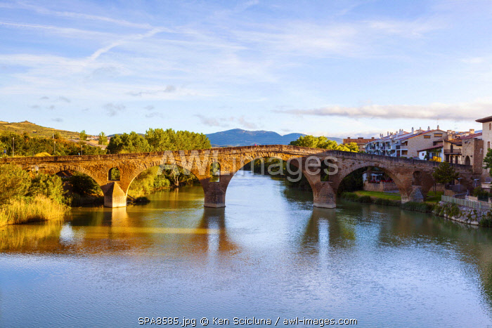 Spain. Navarra. Puenta La Reina. The Romanesque Bridge probably one of the most famous along the Camino Routes built by Queen Muniadona who gave the bridge and town the name for the use of Pilgrims going on ther way to Santiago de Compostela. Puenta la Reina is also important as it links different routes amongst them the Camino Aragonese onto the Camino Frances which is the most popular way to Santiago.