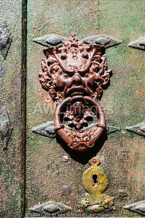 Spain, Navarre, Cirauqui. Door knocker in the hamlet of Cirauqui on the Camino Frances just after Puenta La Reina where the several routes meet to continue towards Santaigo de Compostela towards the village of Cirauqui .