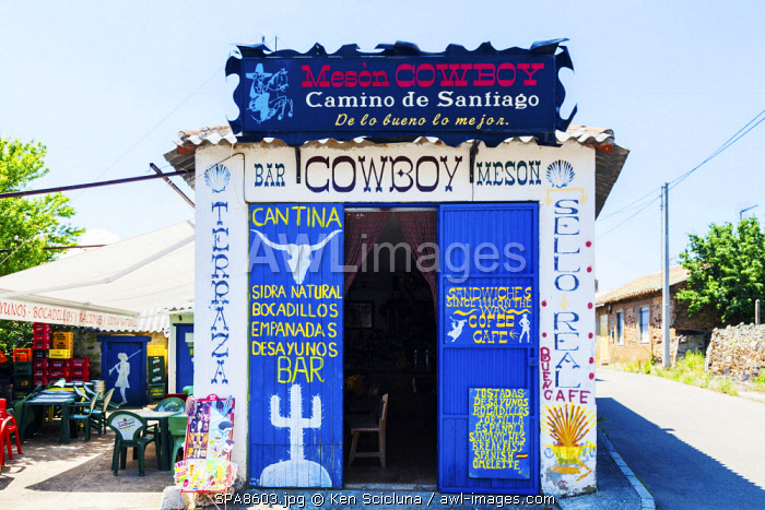 Spain, Casila y Leon, El Ganso. The very atmospheric cowboy bar as if something from a Serio Leone movie in the hamlet of El Ganso with cowboy memorabilia and old cowboy movies showing on tv.