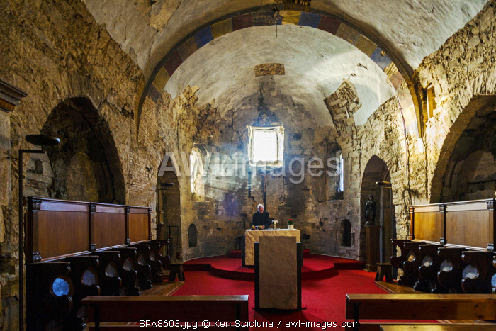 Spain, Castilla y Leon, Rabanal del Camino. A benedictine monk in the Church of the Benedictine Monastery San Salvador del Monte Irago which follows the strict tradition of St Benedict with morning prayers and vespers sung daily during set hours.