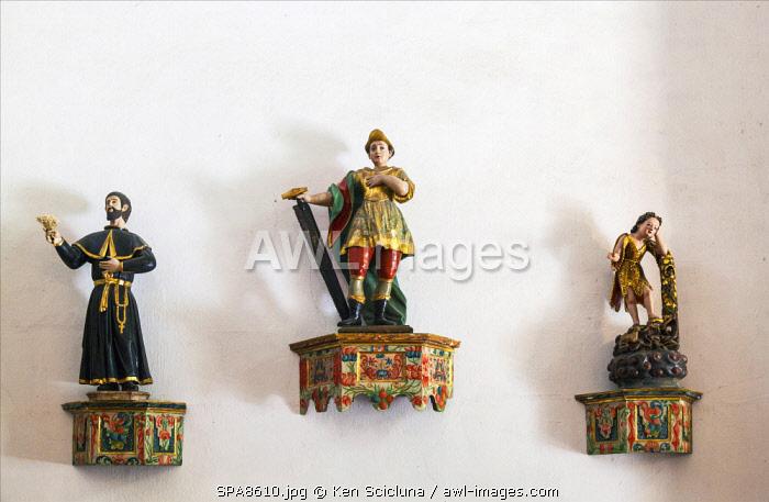 Spain, Castila y Leon, El Bierzo, Molinaseca. Statues in a church on the French Way in Molinaseca.