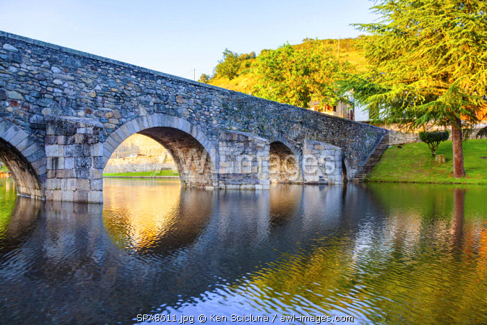 Spain, Castila y Leon, El Bierzo, Molinaseca. A Roman Bridge over the Meruelo River on the Camino Frances on the way to Santiago de Compostela.