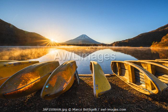 Boats moored at lake Shoji and Mt. Fuji, Yamanashi Prefecture, Japan.