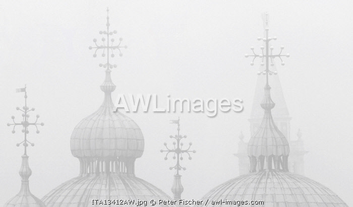Silhouettes of St. Mark's Cathedral and Campanile San Giorgio Maggiore in the fog, Venice, Veneto, Italy.