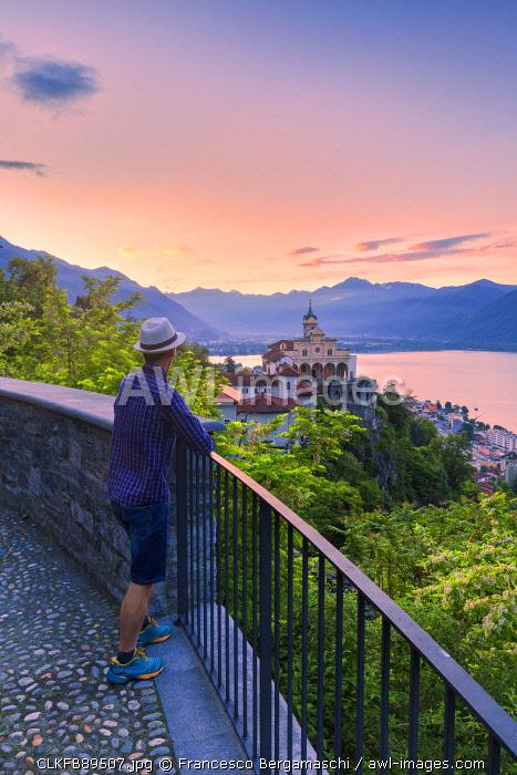 Tourist looks from above the Sanctuary of Madonna del Sasso, Orselina, Locarno, Lake Maggiore, Canton of Ticino, Switzerland, Europe. (MR)