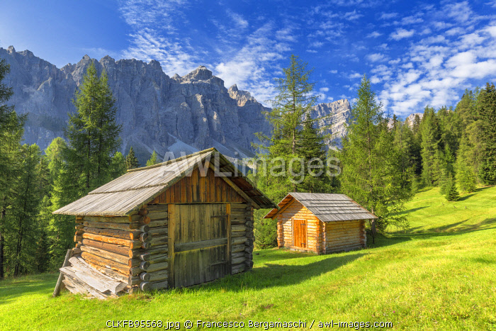 Traditional hut with Puez Group in the background. Longiarù, Badia Valley, South Tyrol, Dolomites, Italy, Europe.