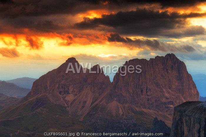 Stunning sunset on Sassolungo group. Fassa Valley, Trentino, Dolomites, Italy, Europe.