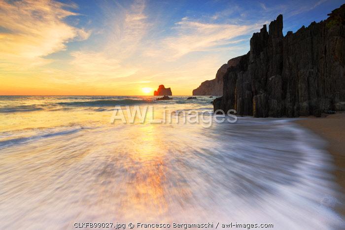 Waves at sunset on the Beach of Masua, Iglesias, Sud Sardegna province, Sardinia, Italy, Europe.