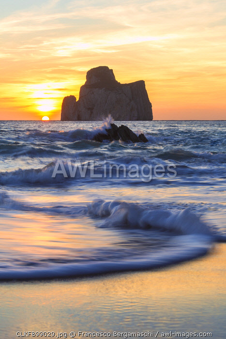 The sunset is reflected on the Beach of Masua, Iglesias, Sud Sardegna province, Sardinia, Italy, Europe.