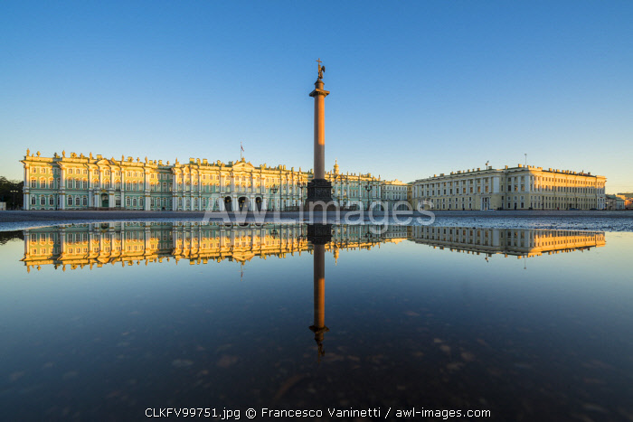 Winter Palace and Alexander Column reflecting on a pond after the rain in Palace Square at dawn. Saint Petersburg, Russia.