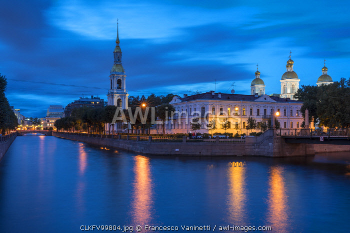 The bell tower and domes of Saint Nicholas Naval Cathedral on Griboyedov Canal at dusk. Saint Petersburg, Russia.