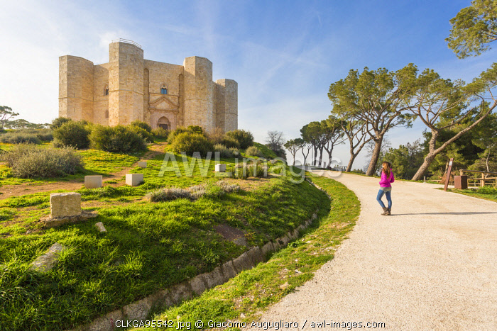 A tourist admiring Castel del Monte fortress in Andria, Apulia region, Italy (MR)