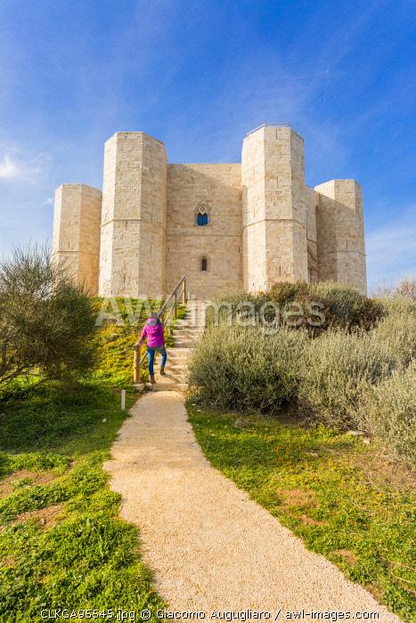 Tourist admiring Castel del Monte fortress in Andria, Apulia region, Italy (MR)