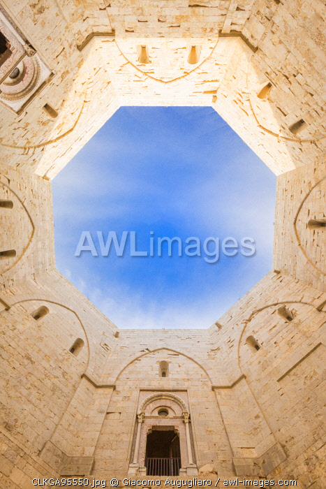 Cutting of sky viewed from the inside courtyard of Castel del Monte fortress in Andria, Apulia region, Italy