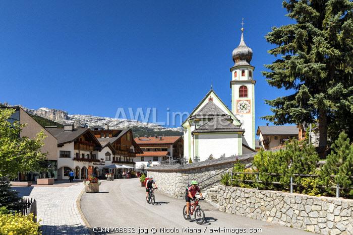Cycling in San Cassiano village, Val Badia, Trentino Alto Adige, Italy, Europe.