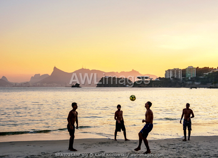 awl-images.com - Brazil / People playing football on Icarai Beach at sunset, Niteroi, State of Rio de Janeiro, Brazil