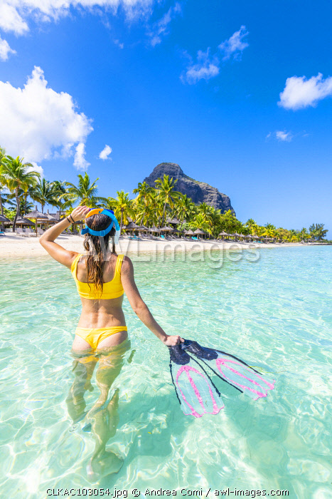 A Young woman with mask and fins at Le Morne Beach. Le Morne Brabant Peninsula, Black River (Riviere Noire), Mauritius, Africa (MR)