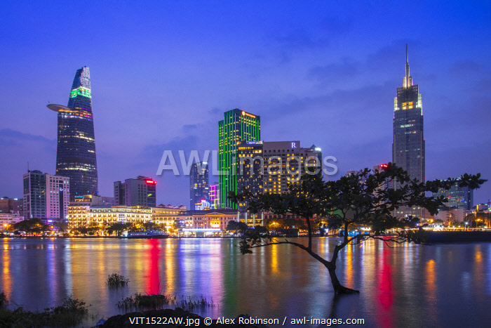 Asia, Southeast Asia, Vietnam, Southern Vietnam, Ho Chi Minh City, the illuminated skyline of the city reflected in the Saigon river