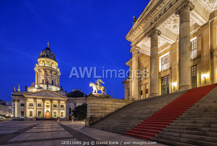 The Gendarmenmarkt is a square in Berlin and the site of an architectural ensemble including the Konzerthaus (concert hall) and the French and German Churches. The latter shown in the photo. On the right the concert hall.